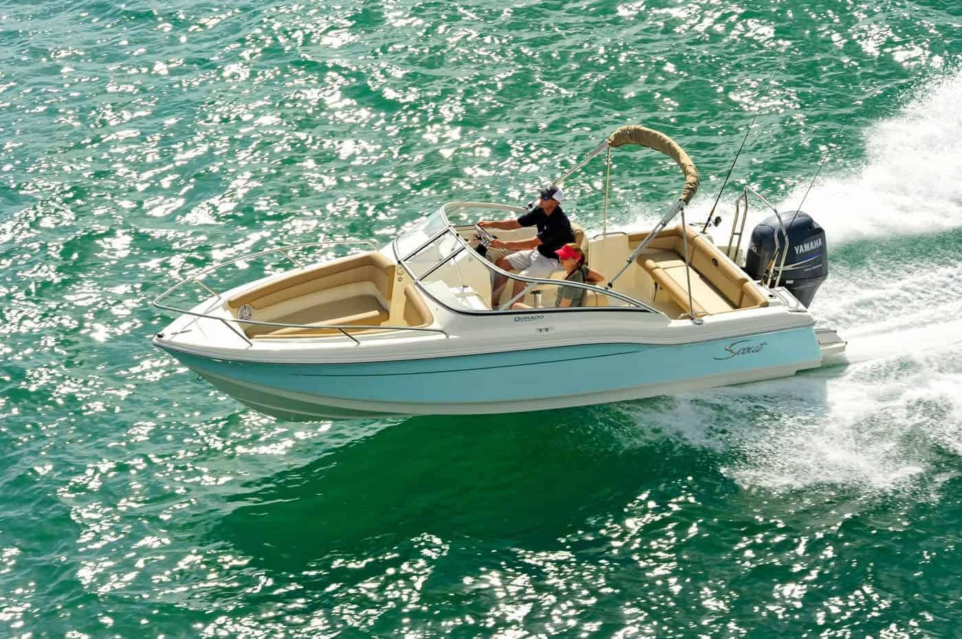 210D running shot with man sitting at helm
