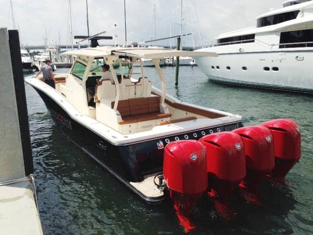 Scout with red engines as a yacht tender